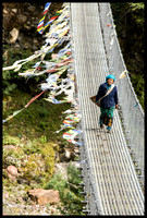 Woman On Suspension Bridge
